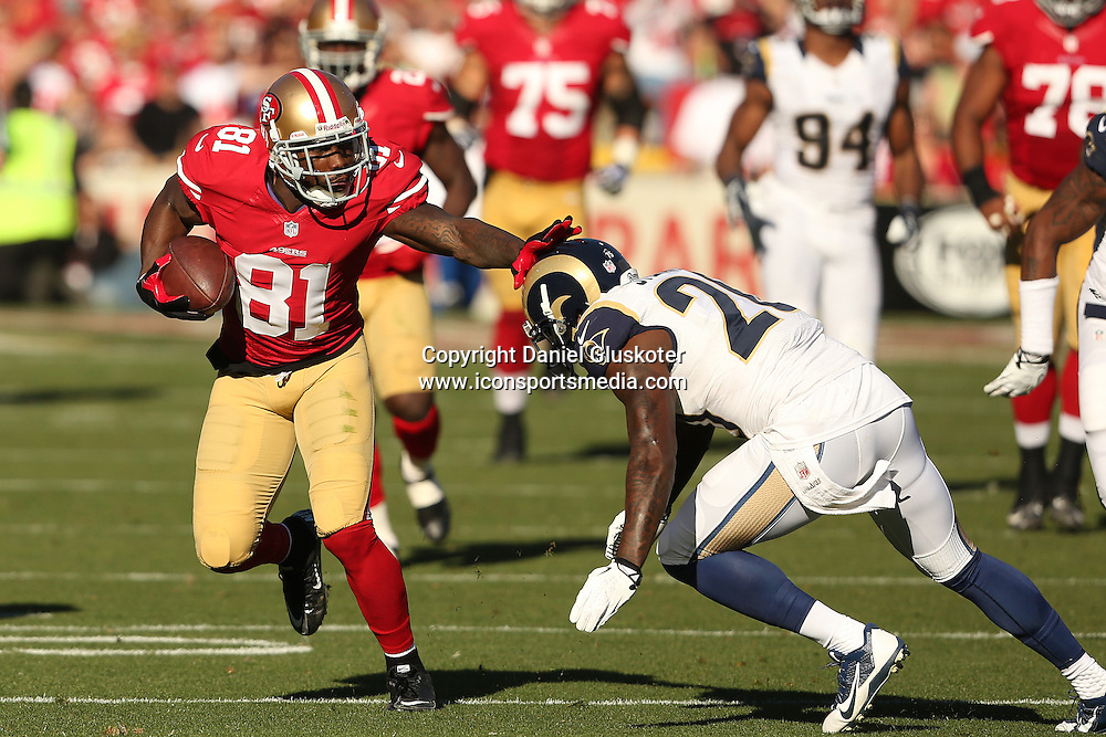 01 December 2013: Niners receiver Anquan Boldin attempts to elude Darian Stewart during action in an NFL game against the St. Louis Rams at Candlestick Park in San Francisco, CA. The 49ers won 23-13.