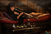 "Am I not desirable? Seductive, beautiful woman portrayed by alternative model Sabrina Sin, smoking opium in an ornate pipe, a forbidden pleasure among the liberated French females of the 1930's. She is being carried away by the effects of the drug surrendering herself to the drug. This collection was inspired by the writings of Brassai in his book ""The Secret Paris of the 1930's""."