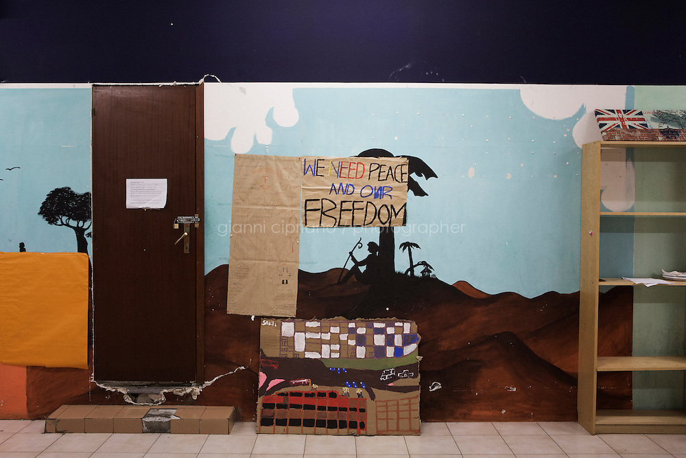 ROME, ITALY - 25 NOVEMBER 2014: A painting made by the  young asylum seekers of the Accommodation Center for Asylum Seekers in Tor Sapienza, a working-class neighborhood in the outskirts of Rome, Italy, on November 25th 2014. Tor Sapienza has seen several days and nights of violence against refugees by residents who blame foreigners for crimes.
