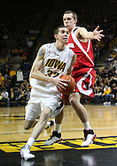 21 JANUARY 2009: Iowa's Jake Kelly (32) gets around Wisconsin's Jason Bohannon (12) during the first half of an NCAA college basketball game Wednesday, Jan. 21, 2009, at Carver-Hawkeye Arena in Iowa City, Iowa. Iowa defeated Wisconsin 73-69 in overtime.