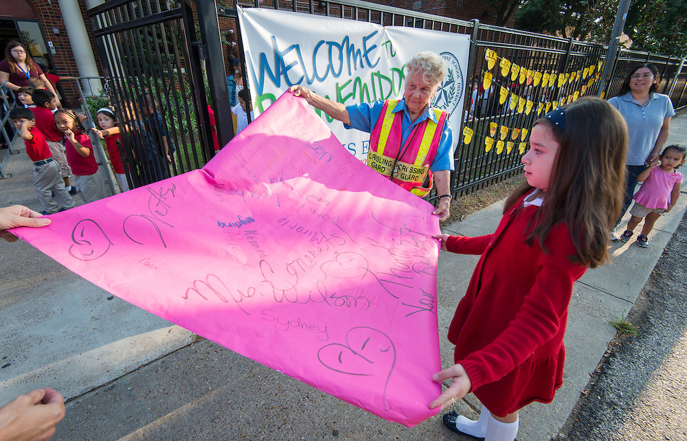 Crossing guard Joy Wilson is recognized by students at Helms Elementary School on her 84th birthday, September 8, 2014.