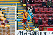 Motherwell FC Forward Louis Moult challenges Hearts FC Goalkeeper Neil Alexander for the cross during the Ladbrokes Scottish Premiership match between Motherwell and Heart of Midlothian at Fir Park, Motherwell, Scotland on 28 November 2015. Photo by Craig McAllister.