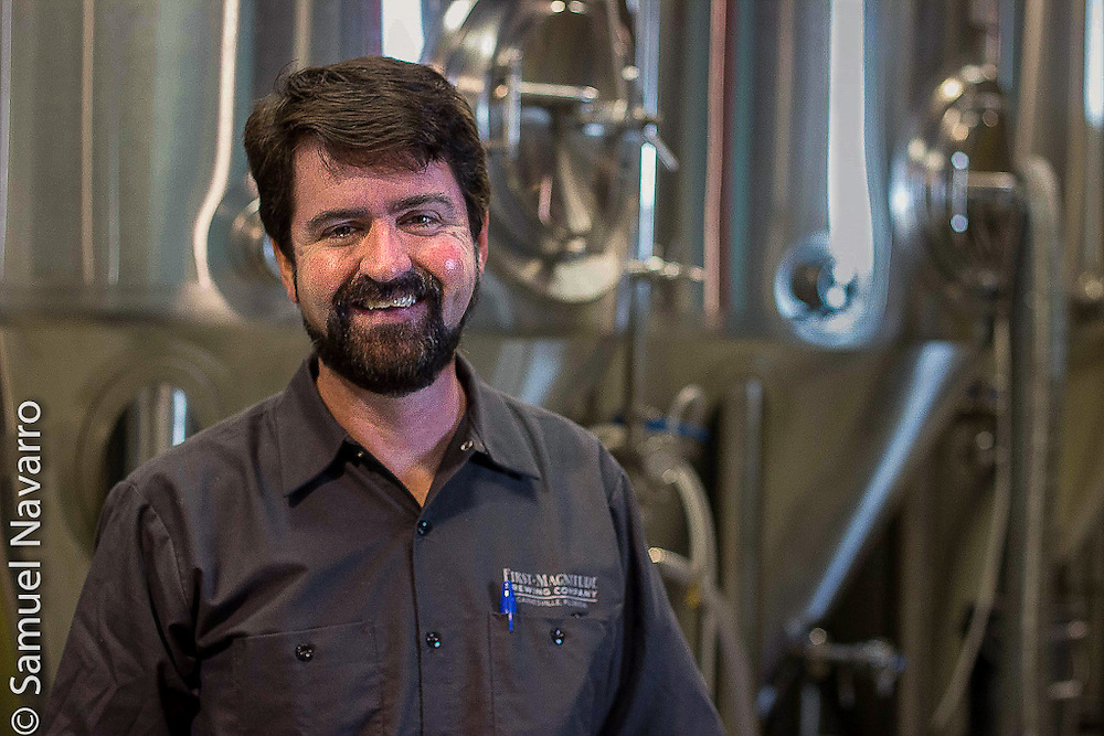 Denny, standing in front of First Magnitude's brewing tanks, poses for a portrait Wednesday, January 21, 2015. (photo by Samuel Navarro)