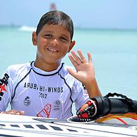 Josh Angulo son in Aruba Hi Winds 2012. Aruba Island, July 3-July 9, 2012. International Competition windsurfing and kite surfing. Jimmy Villalta & Valentina Calatrava