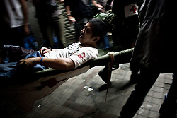 A wounded man being carried to an ambulance vehicle. For over two months, Thailand's capital was shaken by fierce and deadly clashes between protesters and security forces. The standoff has taken the lives of at least 89 people and left way more than 1,800 people injured so far.