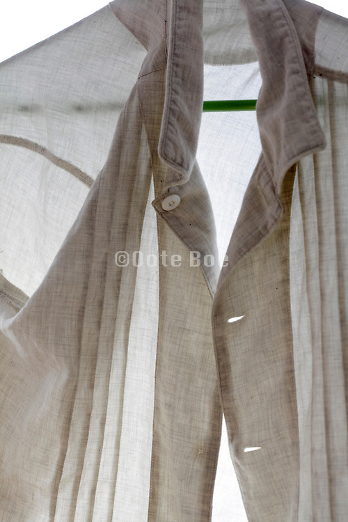 detail of a shirt casually hanged on a coathanger