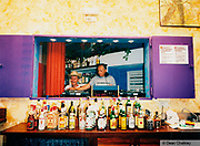 Bottles of alcohol lined up on the bar, Ibiza, 1998