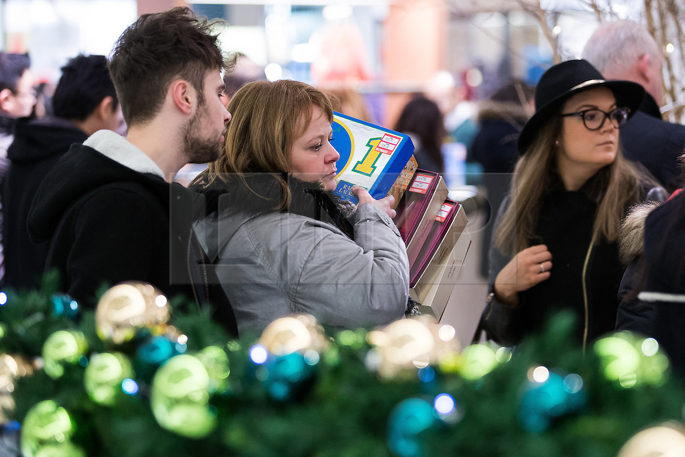 © Licensed to London News Pictures . 26/12/2014 .  Manchester , UK . Crowds of bargain hunters in Selfridges in Manchester City Centre for the Boxing Day Sale . Photo credit : Joel Goodman/LNP