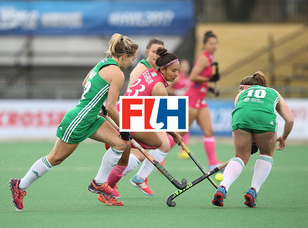 JOHANNESBURG, SOUTH AFRICA - JULY 8: Maho Segawa of Japan takes on the Ireland defence during the pool A match between Japan and Ireland on day one of the FIH Hockey World League Semi-Final at Wits University on July 8, 2017 in Johannesburg, South Africa. (Photo by Jan Kruger/Getty Images for FIH)