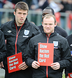"""IRDNING, AUSTRIA - Wednesday, May 19, 2010: England's Wayne Rooney holds up a card reading """"Show Racism the Red Card"""" during a training session in Irdning as the squad prepare for their World Cup campaign. (Pic by Sandro Zangrando/Expa/Propaganda)"""