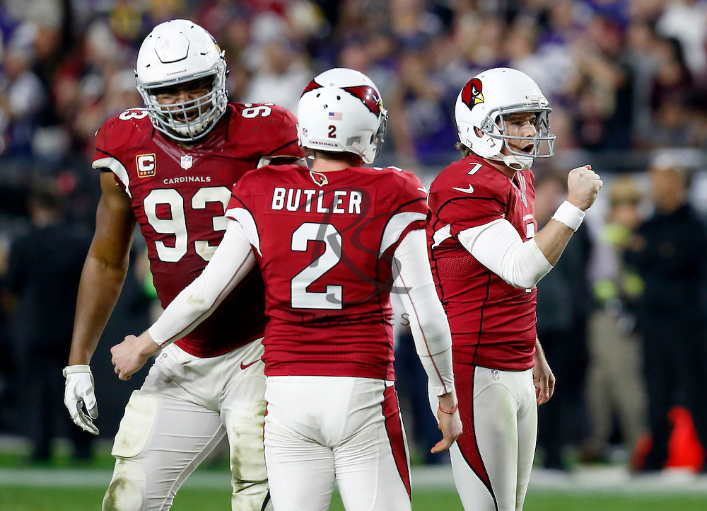 Arizona Cardinals kicker Chandler Catanzaro (7) celebrates his field goal during the second half of an NFL football game against the Minnesota Vikings with Drew Butler (2) and Calais Campbell (93) , Thursday, Dec. 10, 2015, in Glendale, Ariz. (AP Photo/Rick Scuteri)