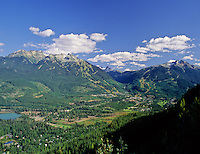 Aerial view of Whistler Resort, BC Canada, on a summer day, features both Whistler and Blackcomb mountains.