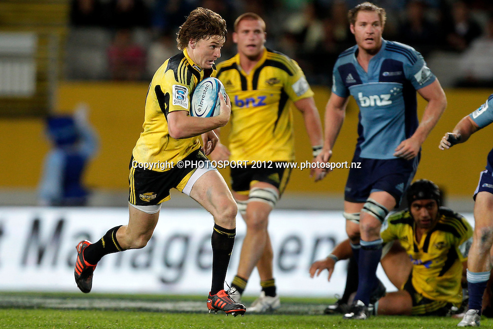 Beauden Barrett of the Hurricanes makes a break during the Super Rugby game between The Blues and The Hurricanes at Eden Park, Auckland New Zealand, Friday 23 March 2012. Photo: Simon Watts / photosport.co.nz