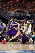 ST. LOUIS, MO - MARCH 26: Adam Koch #34 of the Northern Iowa Panthers dives for a loose basketball ahead of teammate Kwadzo Ahelegbe #11 and Raymar Morgan #2 of the Michigan State Spartans during the Midwest regional semi-final of the NCAA men's basketball tournament at the Edward Jones Dome on March 26, 2010 in St. Louis, Missouri. Michigan State advanced with a 59-52 win. (Photo by Joe Robbins)