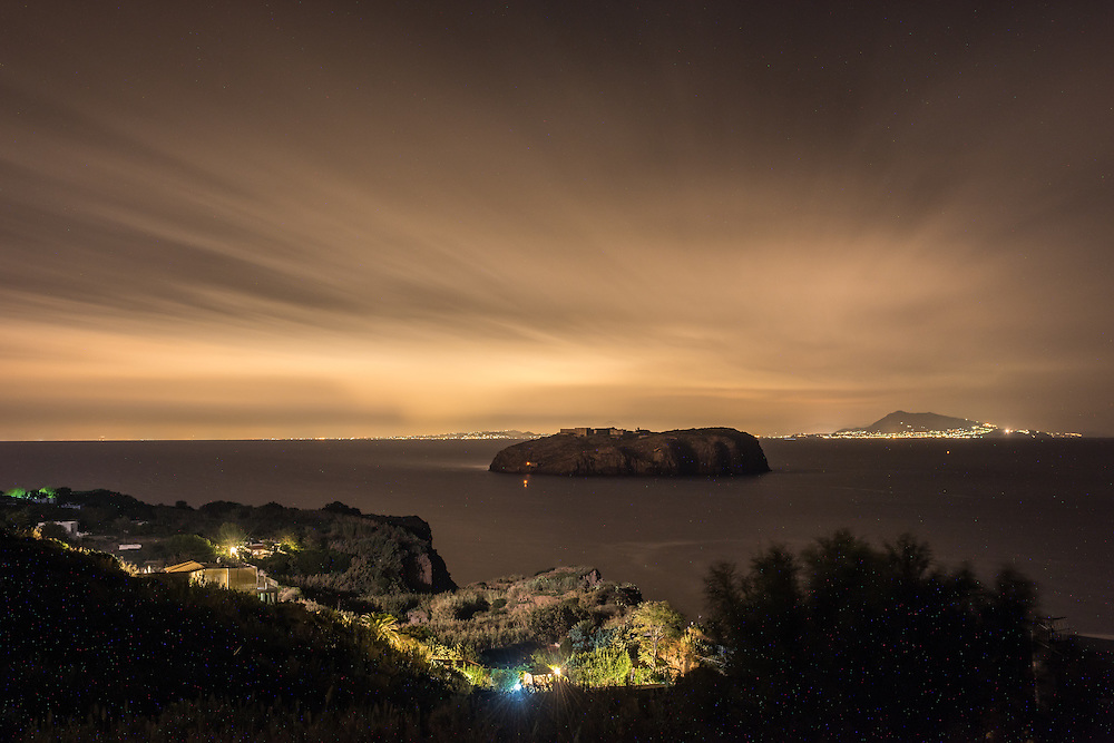 Ventotene Island, Italy - 22 September 2014: the view on the small island of Santo Stefano and Ischia Island at night.