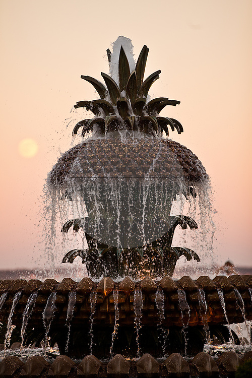 Pineapple fountain at sunset in Riverfront Park along the harbor in Charleston, SC.