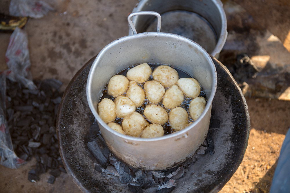 Potatoes (Solanum tuberosum) boil in a large pot in Ganta, Liberia