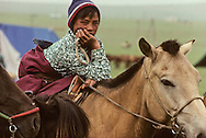 Mongolia. Youg boy riding horse outside OulanBator   /  Cavaliers de la steppe à la sortie de Oulan bator