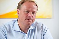 07 SEP 2010, BERLIN/GERMANY:<br /> Dirk Niebel, FDP, Bundesentwicklungshilfeminister, waehrend einem Interview, in seinem Buero, Bundesministerium fuer wirtschaftliche Zusammenarbeit und Entwicklung<br /> IMAGE: 20100907-01-009