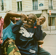 Teenage boys in Paris play fighting in the street