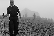 A cold mist covers the chapel on the summit of Croagh Patrick mountain.