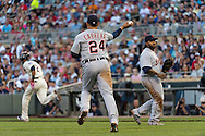 Miguel Cabrera #24 of the Detroit Tigers makes a running throw to 1st base during a game against the Minnesota Twins on June 15, 2013 at Target Field in Minneapolis, Minnesota.  The Twins defeated the Tigers 6 to 3.  Photo: Ben Krause