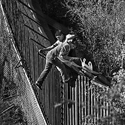 Women tries to cross  the U.S. border fence with the help of human smuggler.
