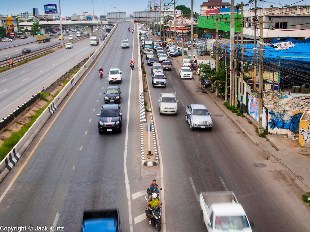20 JUNE 2014 - SAMUT SAKHON, SAMUT SAKHON, THAILAND: Thai Highway  35 cuts through through the fishing town of Samut Sakhon and goes to Samut Songkram, another fishing port.    PHOTO BY JACK KURTZ