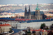 Prague Castle and St. Vitus Cathedral. The Guinness Book of Records lists Prague Castle as the largest ancient castle in the world.It occupies an area of almost 70,000 m2, at about 570 meters in length and an average of about 130 meters wide.