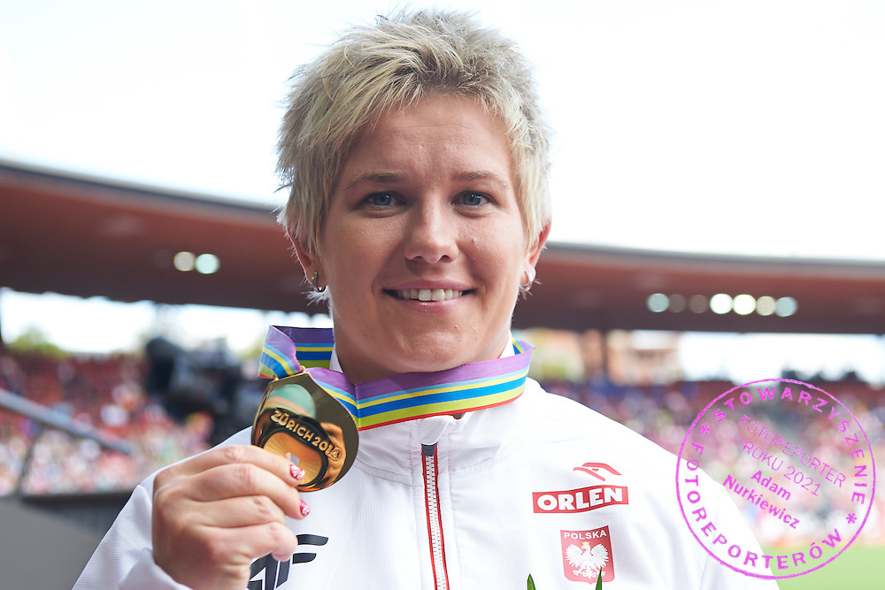 Anita Wlodarczyk from Poland poses with her gold medal in women's hammer throw while medal ceremony during the Fifth Day of the European Athletics Championships Zurich 2014 at Letzigrund Stadium in Zurich, Switzerland.<br /> <br /> Switzerland, Zurich, August 16, 2014<br /> <br /> Picture also available in RAW (NEF) or TIFF format on special request.<br /> <br /> For editorial use only. Any commercial or promotional use requires permission.<br /> <br /> Photo by &copy; Adam Nurkiewicz / Mediasport