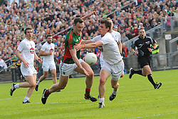 Mayo&rsquo;s Diarmuid O&rsquo;Connor challenged by Kildare&rsquo;s Emmet Bolton during the football qualifer at McHale Park on saturday last.<br />