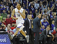 KANSAS CITY, MO - DECEMBER 21:  Guard Nick Russell #12 of the Kansas State Wildcats reacts after hitting a shot from mid-court, as the first half ends against the UNLV Runnin' Rebels on December 21, 2010 at the Sprint Center in Kansas City, Missouri.  UNLV defeated Kansas State 63-59.  (Photo by Peter G. Aiken/Getty Images) *** Local Caption *** Nick Russell