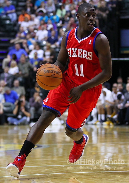 March 14, 2012; Indianapolis, IN, USA; Philadelphia 76ers point guard Jrue Holiday (11) dribbles the ball around the back court against the Indiana Pacers at Bankers Life Fieldhouse. Mandatory credit: Michael Hickey-US PRESSWIRE
