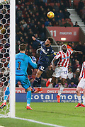 Leeds United forward Tyler Roberts (11) wins a header against Stoke City defender Bruno Martins Indi (15)  during the EFL Sky Bet Championship match between Stoke City and Leeds United at the Bet365 Stadium, Stoke-on-Trent, England on 19 January 2019.