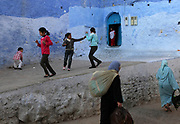 "Children play in Chefchaouen, Morocco, whose ""medina"" (old city) is famous for its striking blue walls."