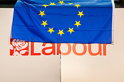 © Licensed to London News Pictures. 21/09/2019. Brighton, UK. An EU flag is draped in seen in the main hall as Shadow Secretary of Stater for Exiting the European Union, Sir Keir Starmer soeaks on stage at the 2019 Labour Party Conference in Brighton and Hove. Photo credit: Hugo Michiels/LNP