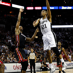 Jun 13, 2013; San Antonio, TX, USA; San Antonio Spurs power forward Tim Duncan (21) shoots against Miami Heat center Chris Bosh (1) during the second quarter of game four of the 2013 NBA Finals at the AT&T Center. Mandatory Credit: Derick E. Hingle-USA TODAY Sports