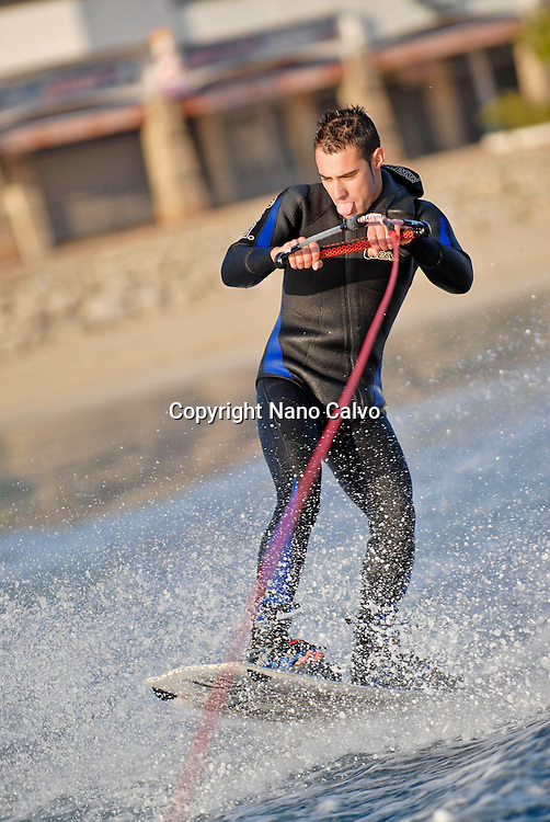 Young man practicing wakeboard in Ibiza