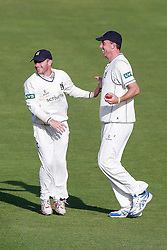 Rikki Clarke of Warwickshire (R) celebrates with Ian Westwood (L) after catching out Jamie Overton of Somerset for 9 - Mandatory byline: Rogan Thomson/JMP - 07966 386802 - 24/09/2015 - CRICKET - The County Ground - Taunton, England - Somerset v Warwickshire - Day 3 - LV= County Championship Division One.