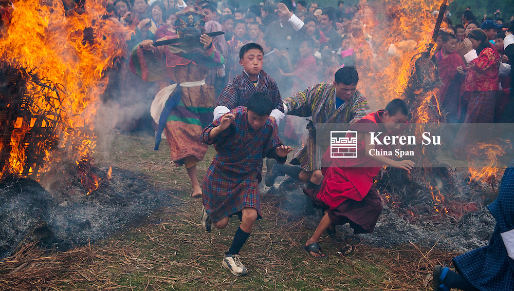 Mewang Festival celebrating Fire God, people going through fire to drive away evil spirts, Bumthang, Bhutan