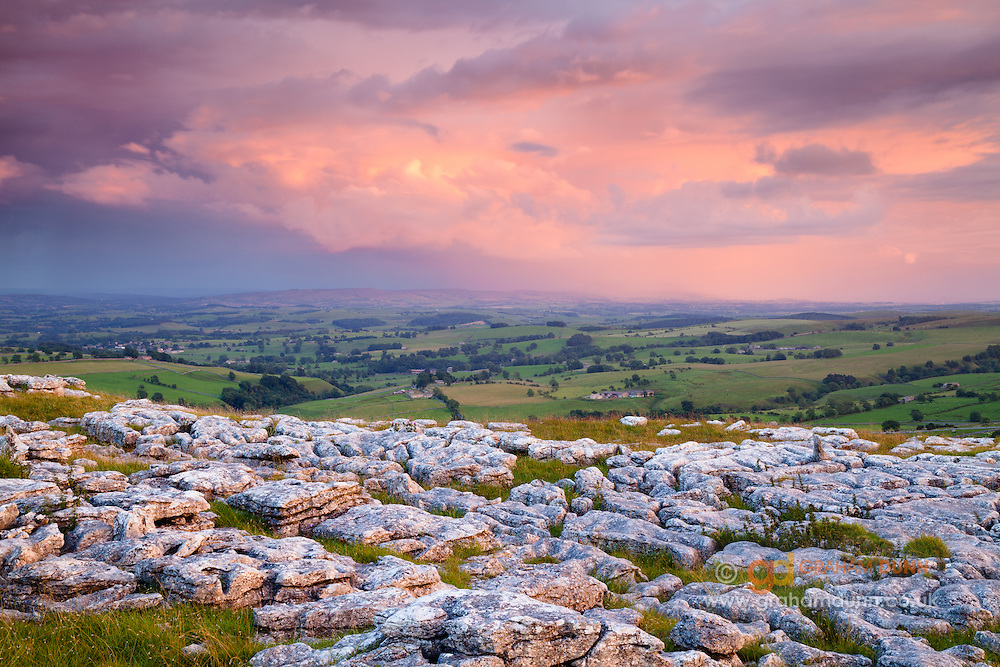 Stormy sunset skies from Malham Lings's limestone pavement. Yorkshire Dales, UK