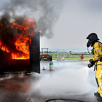 Nederland, Badhoevedorp , 10 oktober 2013.<br /> Brandweer Opleidingscentrum Amsterdam Amstelland Schiphol (Bocas), Sloterweg 527, Badhoevedorp.<br /> Tijdens de rondleiding steekt Brandweer Nederland nagebouwde woonkamer in de brand om te kijken hoe snel dat gaat en Europarlementariër te bewegen impregneren te verplichten en andere brandweerzaken oa innovatie woningsprinklers.<br /> A tour of  MEP Esther de Lange (pic) at the fire brigade Netherlands. A reconstructed living room is set on fire to show the speed and move the EP  to oblige impregnation of houses.