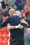 Rob Jones hugs Richard Chaplow of Doncaster Rovers at end of match 2-1 to Doncaster at the Sky Bet League 1 match between Doncaster Rovers and Barnsley at the Keepmoat Stadium, Doncaster, England on 3 October 2015. Photo by Ian Lyall.