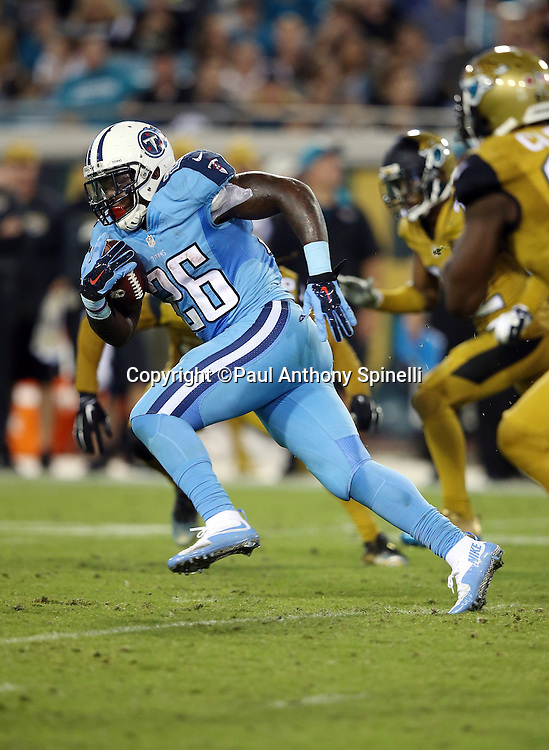 Tennessee Titans running back Antonio Andrews (26) runs the ball during the 2015 week 11 regular season NFL football game against the Jacksonville Jaguars on Thursday, Nov. 19, 2015 in Jacksonville, Fla. The Jaguars won the game 19-13. (©Paul Anthony Spinelli)