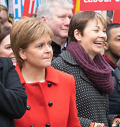 London, February 27th 2016. SNP leader Nicola Sturgeon in red and the Green Party's only MP Caroline Lucas join thousands of protesters on Piccadilly during CND's march and rally opposing the UK's Trident nuclear weapons programme. <br /> &copy;Paul Davey<br /> FOR LICENCING CONTACT: Paul Davey +44 (0) 7966 016 296 paul@pauldaveycreative.co.uk