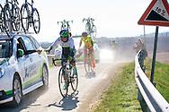 Strade Bianche Women Elite racers after a steep climb on the gravel of strada di Presciano.