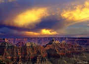 Storm clouds illuminated by the setting sun casts a surreal glow   over the Grand Canyon seen from the national park's north rim viewpoint in Arizona.