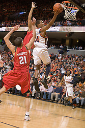 Virginia guard Sean Singletary (44) shoots a layup past Maryland guard Greivis Vasquez (21).  The Virginia Cavaliers defeated the Maryland Terrapins 91-76 at the University of Virginia's John Paul Jones Arena  in Charlottesville, VA on March 9, 2008.