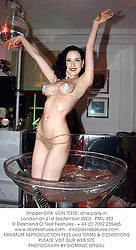Stripper DITA VON TEESE, at a party in London on 21st September 2003.  PMU 453