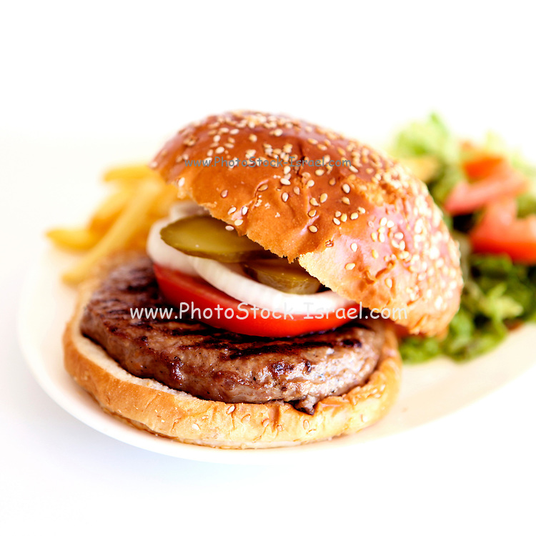 Hamburger with french fries and salad on white background